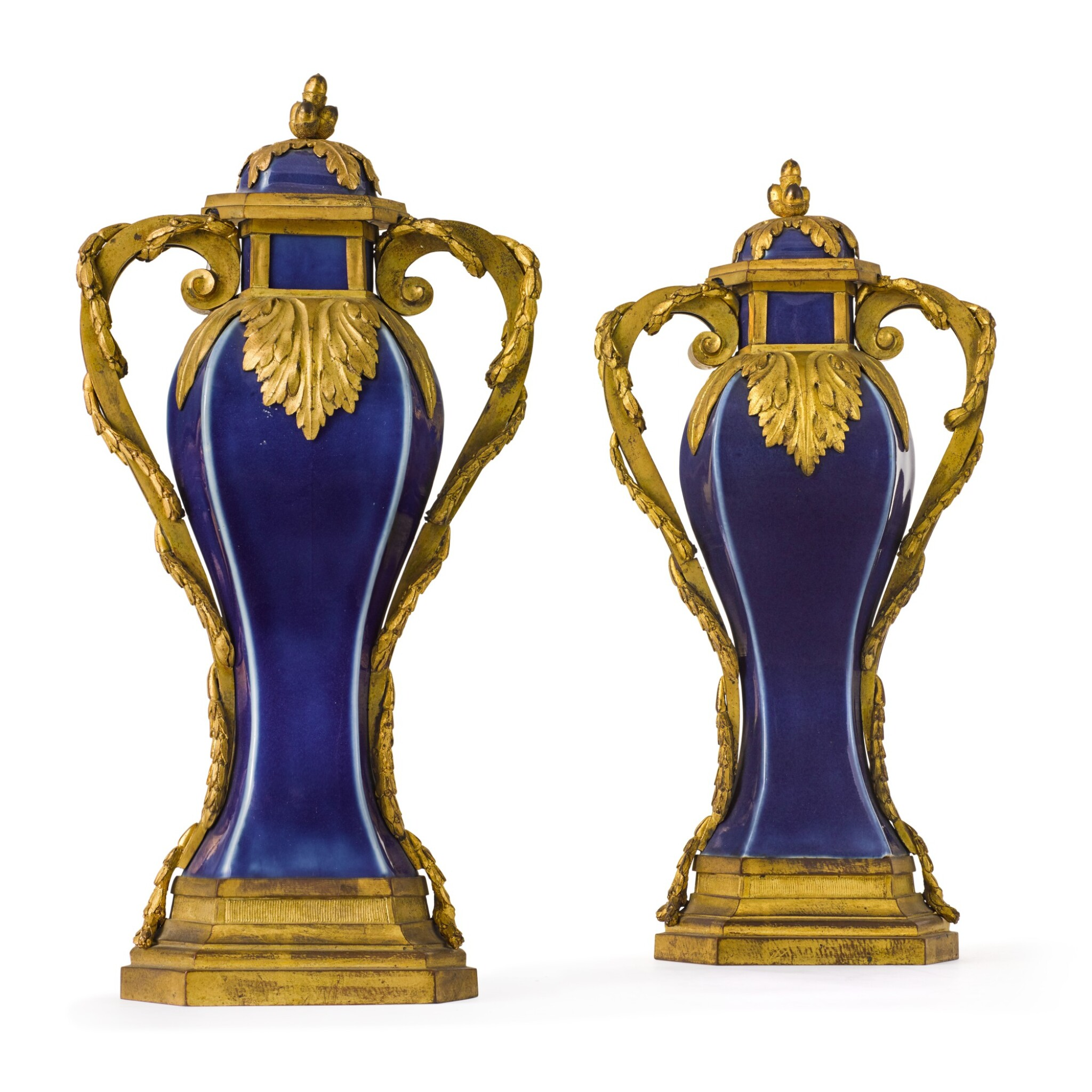 View full screen - View 1 of Lot 126. A pair of Louis XVI gilt-bronze mounted Chinese blue porcelain baluster vases, the mounts circa 1780, the porcelain Qing dynasty, Qianlong (1736-1795).