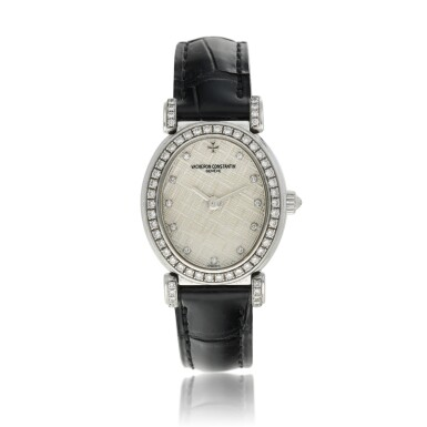 View 1. Thumbnail of Lot 92. Reference 10540   A white gold and diamond-set oval wristwatch, Circa 1994.