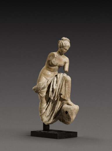 View 1. Thumbnail of Lot 71. A Roman Marble Fountain Figure of a Nymph, circa 1st Century A.D..