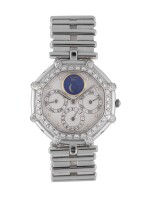 GÉRALD GENTA | REF G2414.4 WHITE GOLD AND DIAMOND-SET ANNUAL CALENDAR BRACELET WATCH WITH MOON PHASES CIRCA 1985