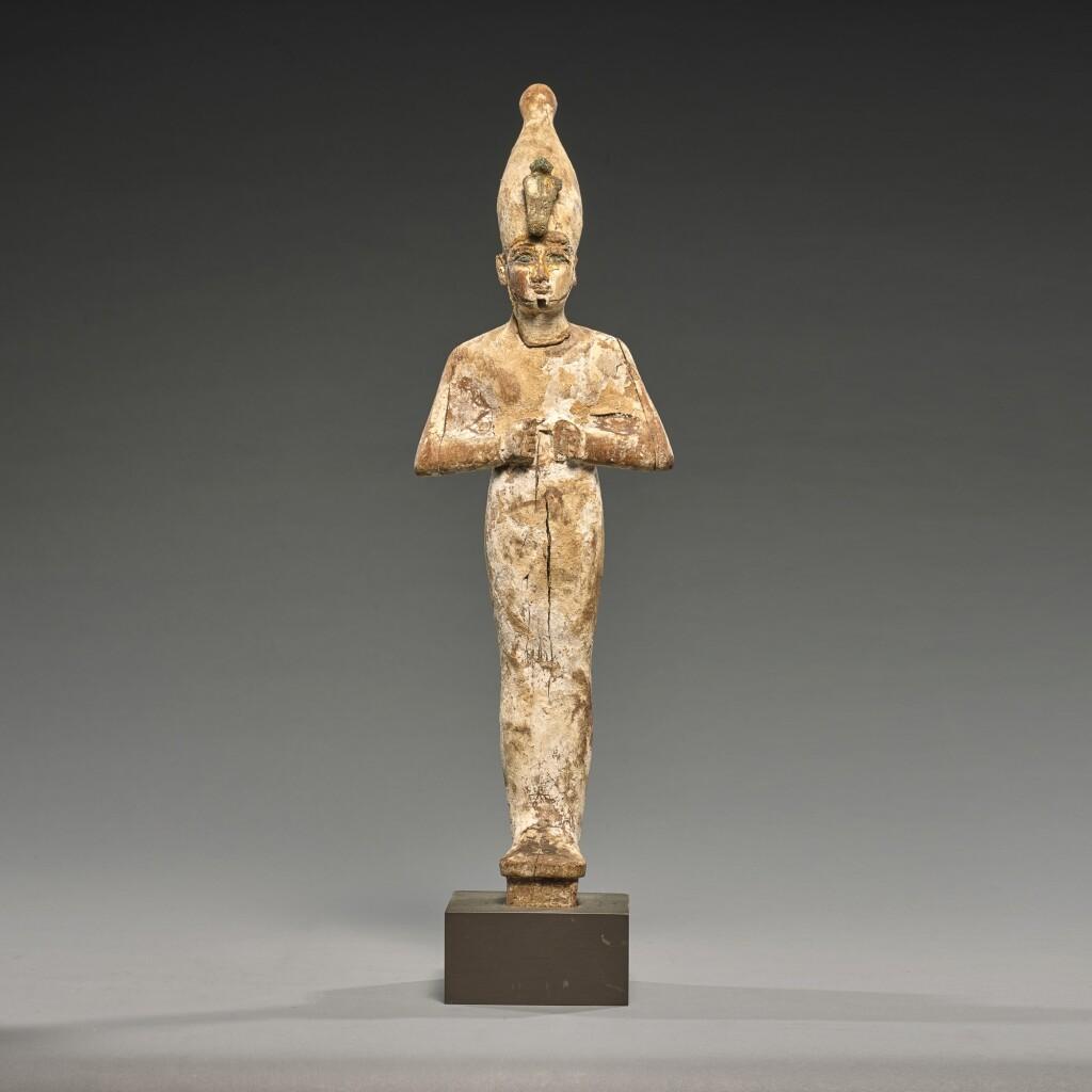 AN EGYPTIAN WOOD FIGURE OF OSIRIS, 3RD INTERMEDIATE PERIOD, 1075-716 B.C.