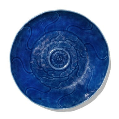 View 1. Thumbnail of Lot 115. A carved blue-glazed dish, Qing dynasty, 18th century .