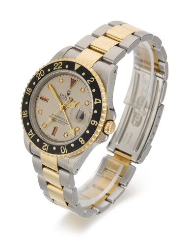 View 2. Thumbnail of Lot 7. ROLEX | GMT-MASTER II SULTAN, REFERENCE 16713, STAINLESS STEEL AND YELLOW GOLD DIAMOND AND RUBY-SET DUAL-TIME WRISTWATCH WITH DATE AND BRACELET, CIRCA 1998.