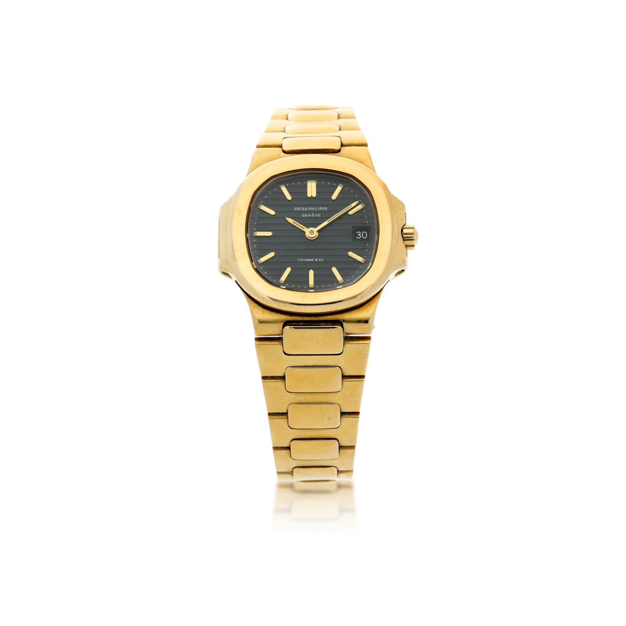 View full screen - View 1 of Lot 34. REFERENCE 4700/1 NAUTILUS RETAILED BY TIFFANY & CO.: A LADY'S YELLOW GOLD BRACELET WATCH WITH DATE, CIRCA 1985.