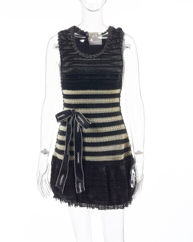 View 1. Thumbnail of Lot 4. Black and off-white striped vinyl dress and ribbon bow brooch.