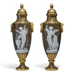 A PAIR OF MINTONS PÂTE-SUR-PÂTE BROWN-GROUND VASES AND COVERS 1892