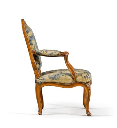 View 3. Thumbnail of Lot 79. A pair of Louis XV carved beechwood fauteuils à la reine, one mid-18th century, the other a later copy.