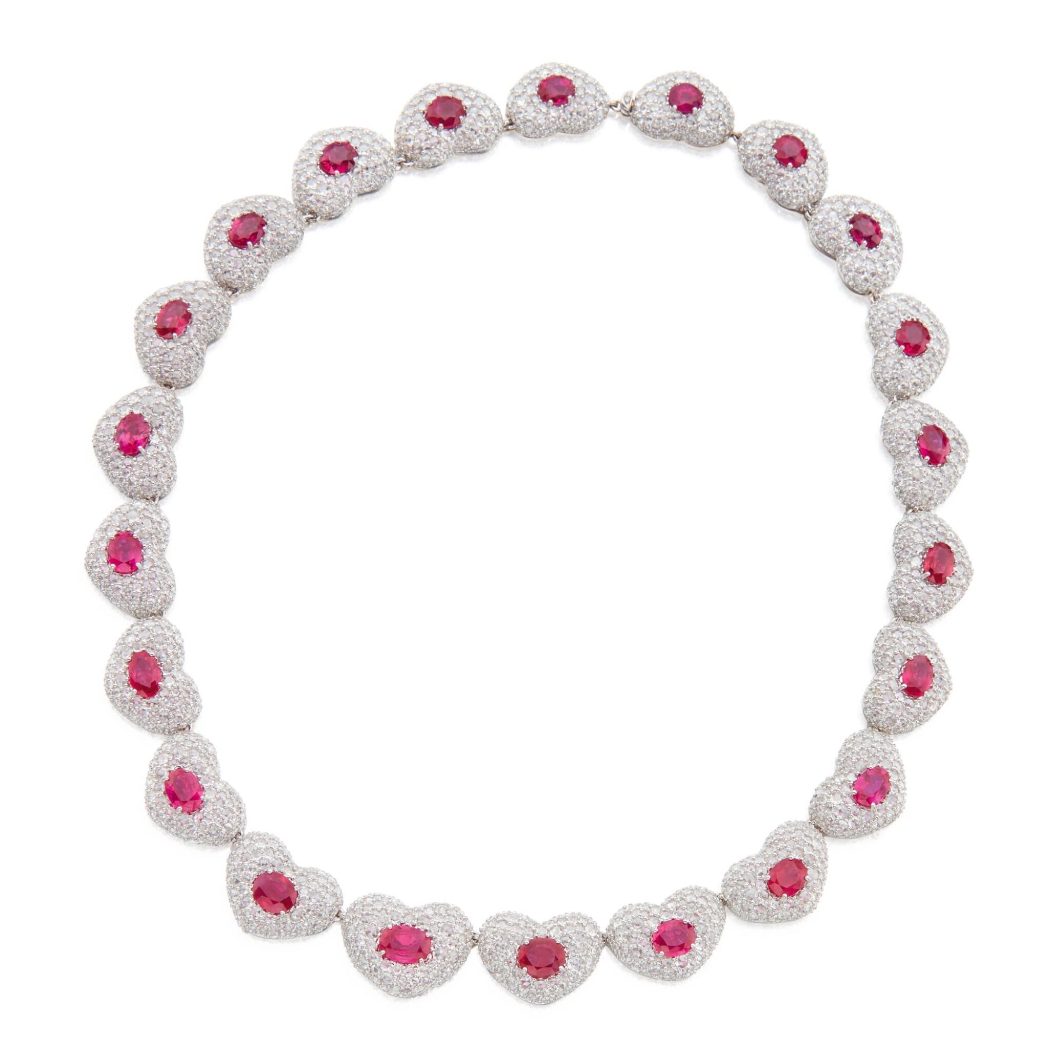 View full screen - View 1 of Lot 424. Michele della Valle | Ruby and Diamond 'Cuori' Necklace.