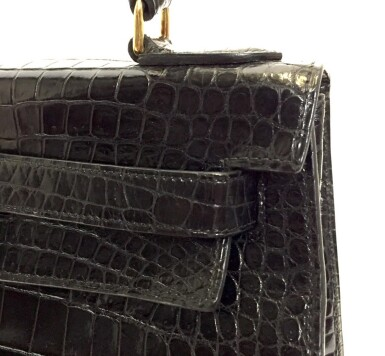 View 9. Thumbnail of Lot 743. HERMÈS | BLACK KELLY 28 IN SHINY CROCODILE WITH GOLD HARDWARE, 1962.