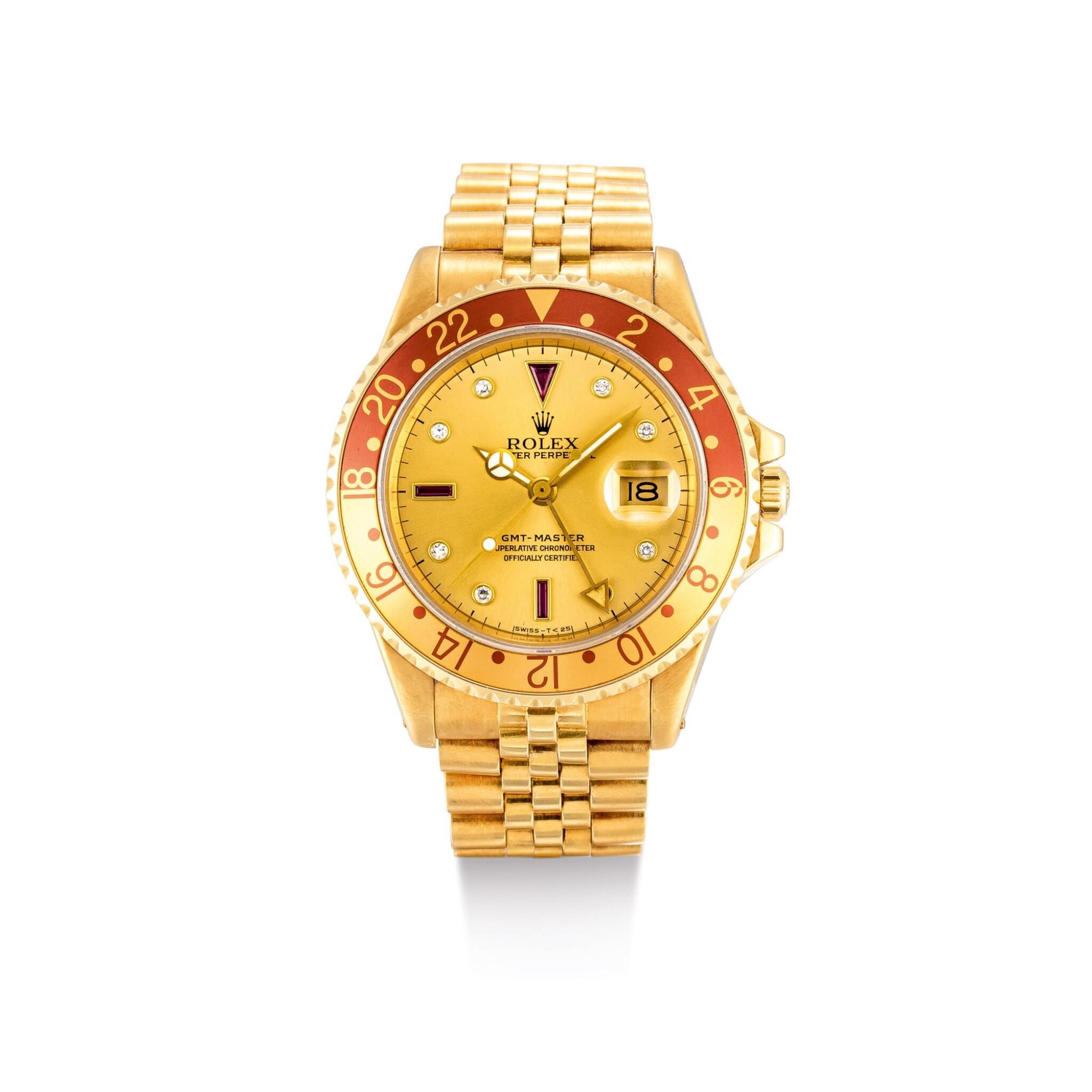 "View 1 of Lot 2018. ROLEX | GMT-MASTER, REFERENCE 16758, A YELLOW GOLD, DIAMOND AND RUBY-SET DUAL TIME ZONE WRISTWATCH WITH DATE AND BRACELET, CIRCA 1987 | 勞力士 | ""GMT-Master 型號16758 黃金鑲鑽石及紅寶石兩地時間鏈帶腕錶,備日期顯示,錶殼編號R288227,約1987年製""."