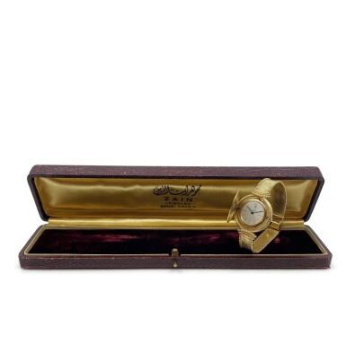 View 10. Thumbnail of Lot 66. A yellow gold coin bracelet watch, Circa 1970.