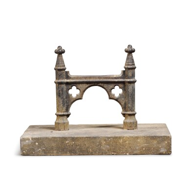 View 1. Thumbnail of Lot 88.   A REGENCY CAST-IRON BOOT-SCRAPER, FIRST QUARTER 19TH CENTURY, OF GOTHIC ARCHITECTURAL-FORM AND SET INTO A CUT-LIMESTONE BLOCK .