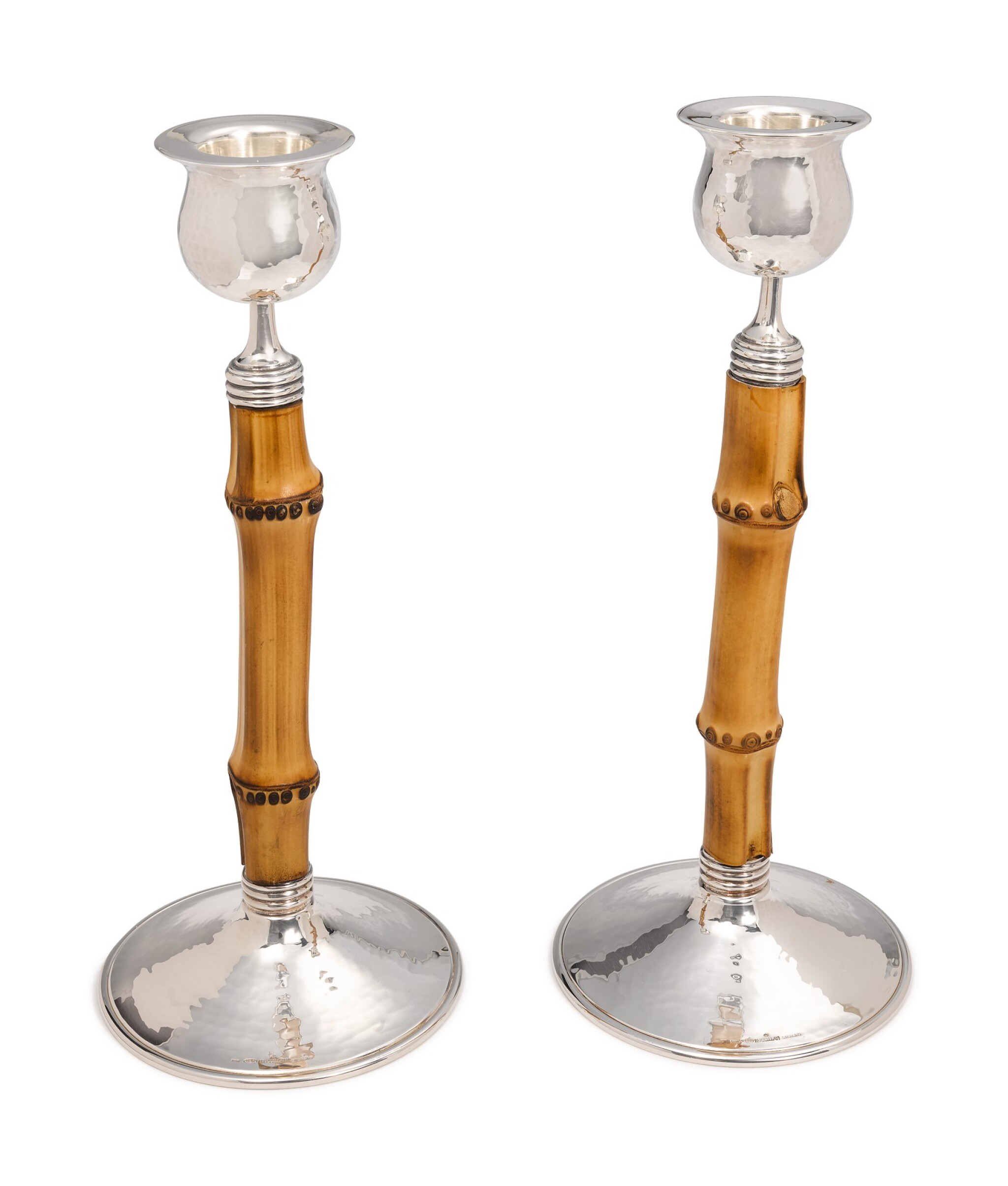 View full screen - View 1 of Lot 317. A PAIR OF ITALIAN SILVER AND BAMBOO TAHITI PATTERN CANDLESTICKS, BUCCELLATI, MILAN, 20TH CENTURY.