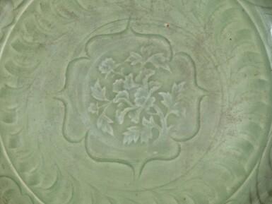 View 4. Thumbnail of Lot 4. Plat en grès céladon Longquan Dynastie Ming | 明 龍泉窰青釉刻花卉紋盤 | A Longquan celadon 'lotus' charger, Ming Dynasty.