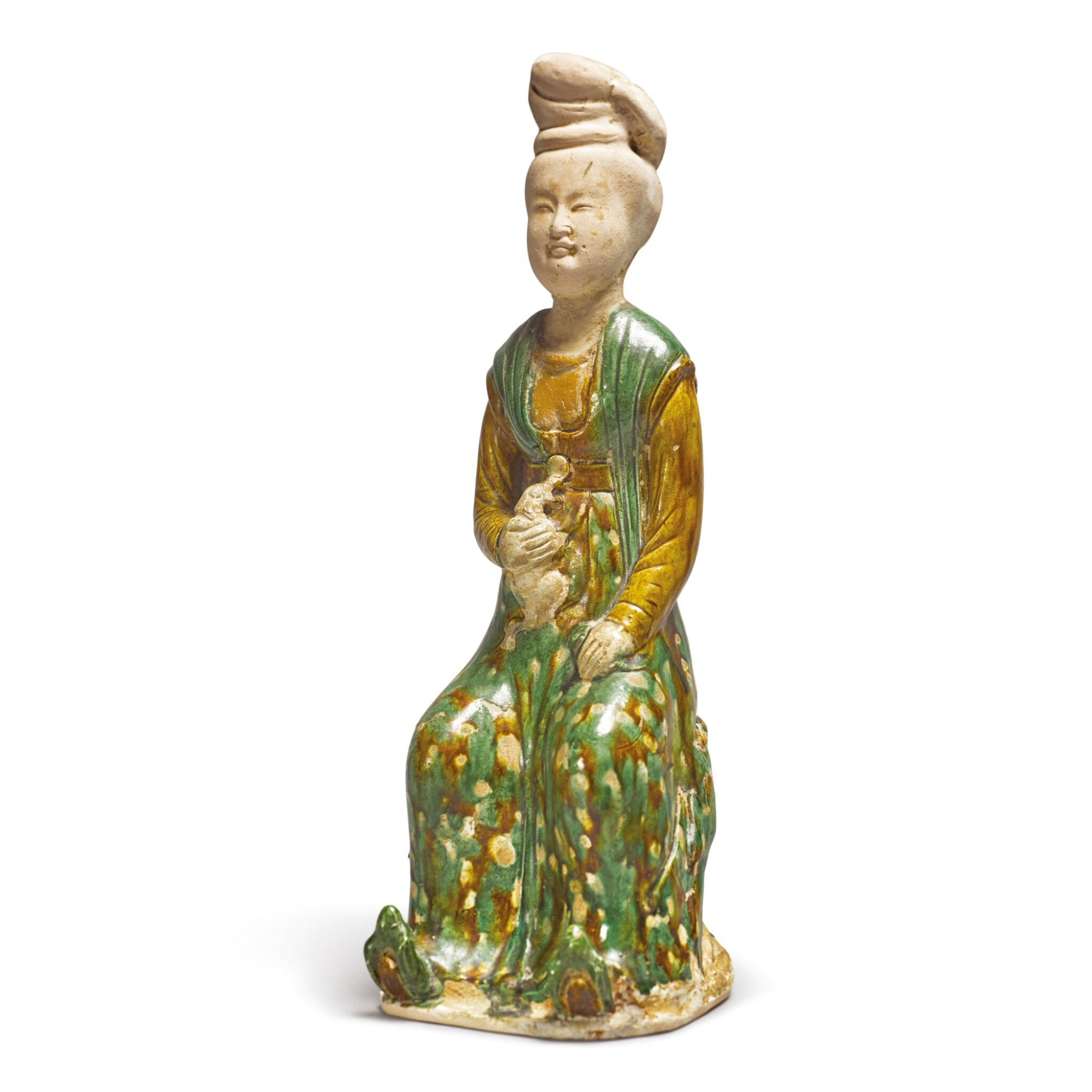 View full screen - View 1 of Lot 691. A RARE SANCAI-GLAZED POTTERY FIGURE OF A SEATED COURT LADY, TANG DYNASTY.