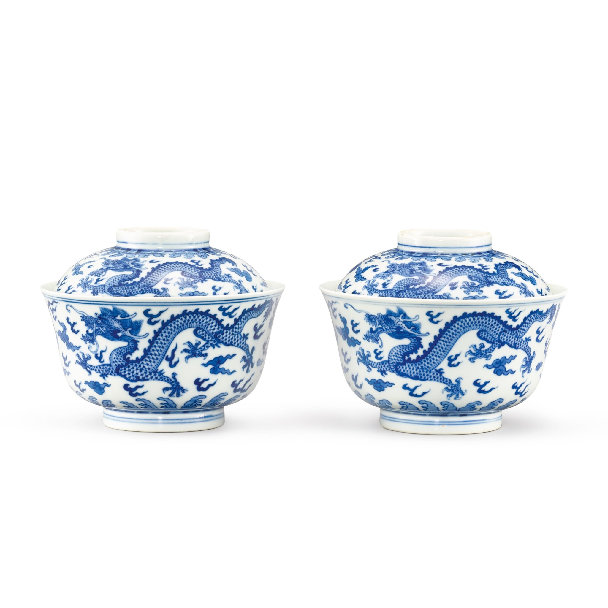 View full screen - View 1 of Lot 109. A SUPERB PAIR OF BLUE AND WHITE 'DRAGON' BOWLS AND COVERS SEAL MARKS AND PERIOD OF DAOGUANG   清道光 青花雲龍紋蓋鐘一對 《大清道光年製》款.