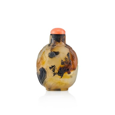 View 1. Thumbnail of Lot 3020. An Inscribed Agate 'Figure, Buddhist Lion and Brocade Ball' Snuff Bottle Suzhou, Qing Dynasty, 18th Century | 清十八世紀 蘇作瑪瑙巧雕胡人戲獅鼻煙壺.