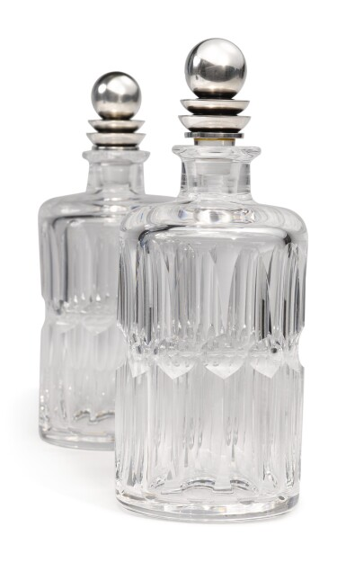 A PAIR OF GLASS DECANTERS WITH DANISH SILVER STOPPERS, NO. 206C, DESIGNED BY HARALD NIELSEN, GEORG JENSEN SILVERSMITHY, COPENHAGEN, CIRCA 1915-27