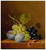 Grapes, plums, raspberries, flowers and an acorn on a wooden ledge