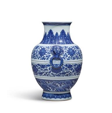 View 4. Thumbnail of Lot 77. A fine blue and white 'floral' vase, Seal mark and period of Qianlong | 清乾隆 青花纏枝花卉紋鋪首耳尊 《大清乾隆年製》款.