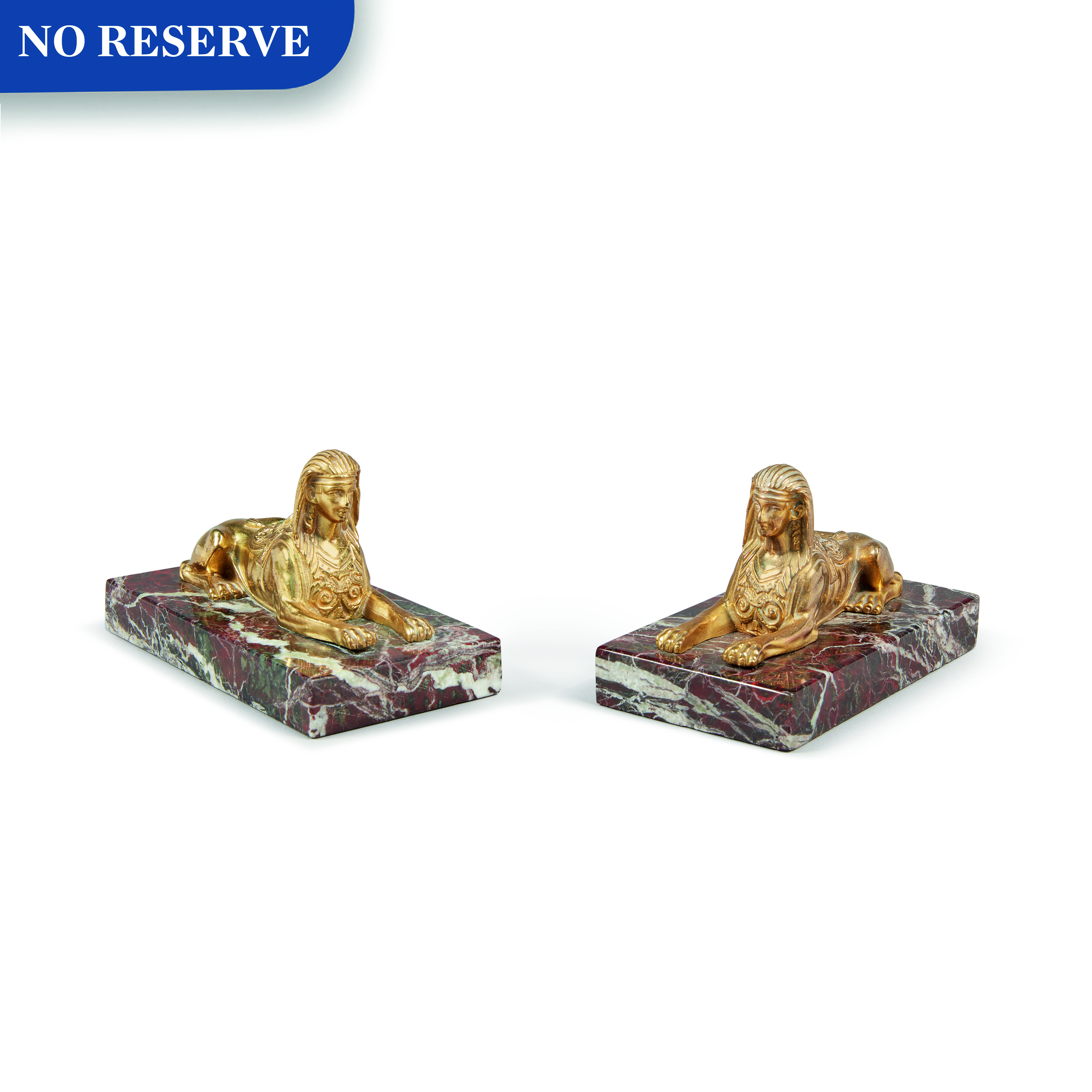 View full screen - View 1 of Lot 130. A PAIR OF EMPIRE GILT BRONZE SPHINXES, 19TH CENTURY.