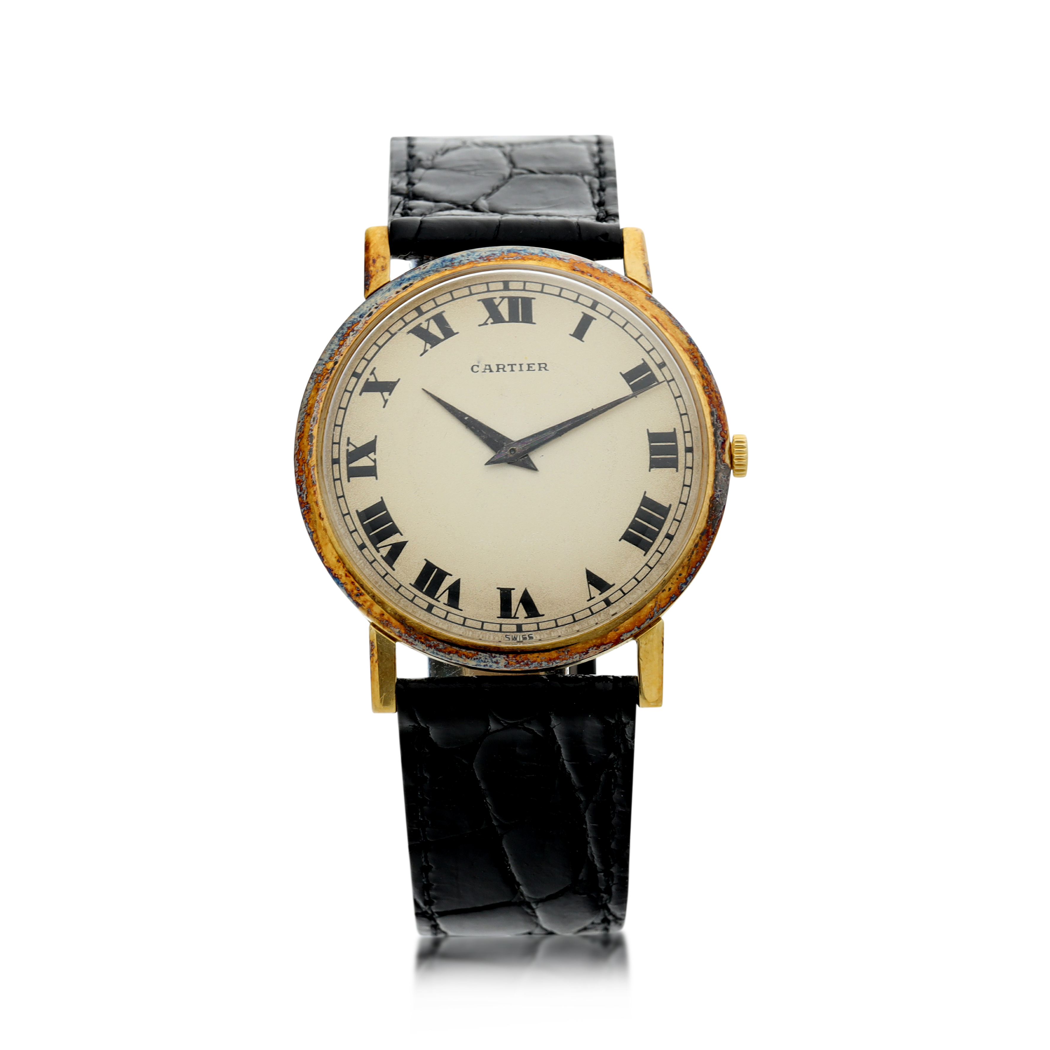 View full screen - View 1 of Lot 71. RETAILED BY CARTIER: A YELLOW GOLD WRISTWATCH, CIRCA 1970.